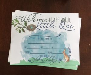 tulsa midwives bring a fun birth certificate for baby